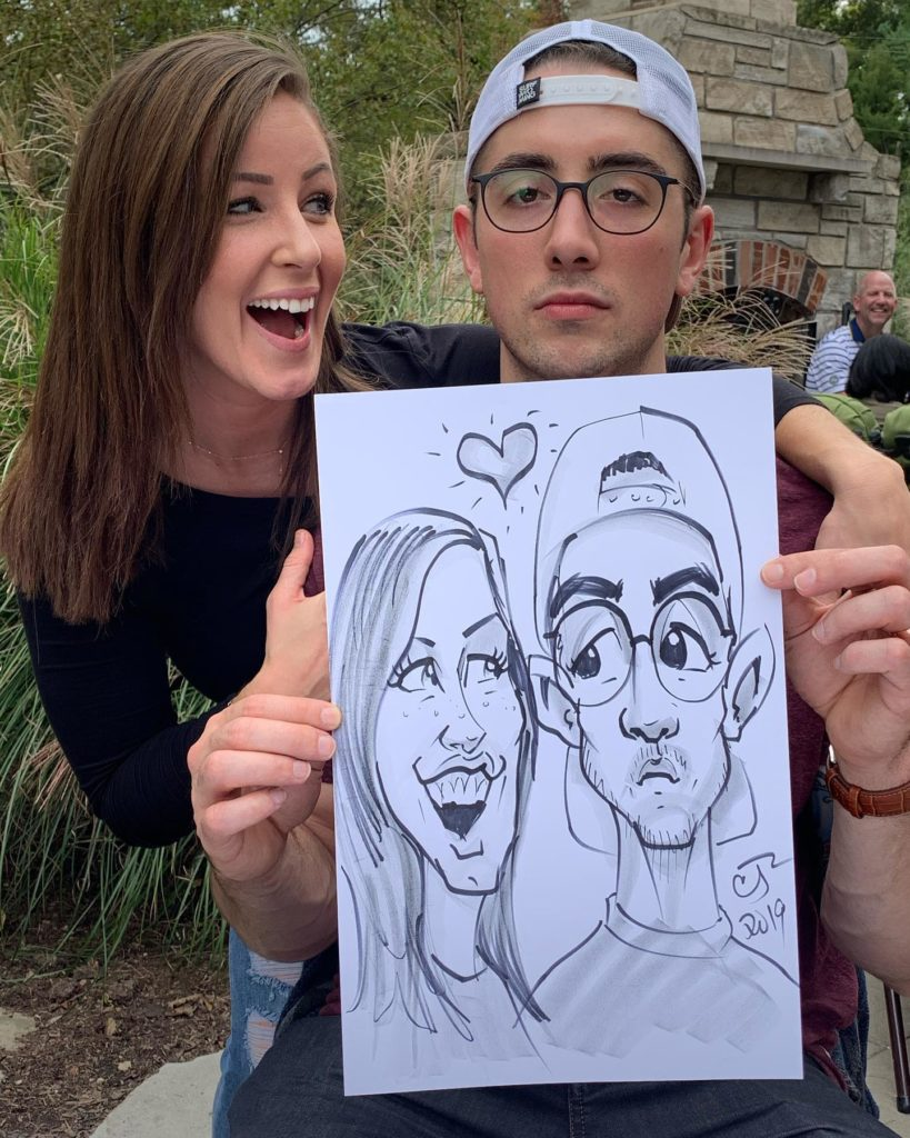 Couple at a party with their caricature